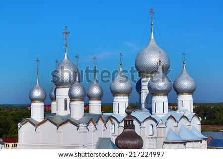 domes of Assumption Cathedral and church of Resurrection in Rostov Kremlin. The ancient town of Rostov The Great is tourist center of Golden Ring of Russia. - stock photo