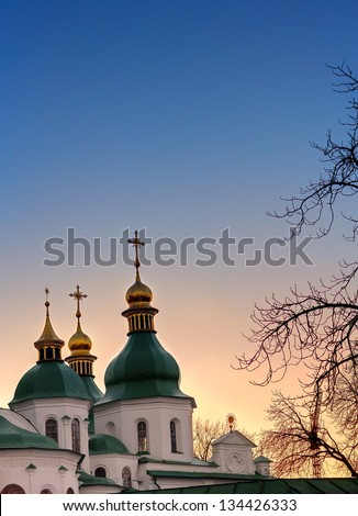 Domes of Saint Sophia Cathedral in Kiev over dramatic sunset sky - stock photo