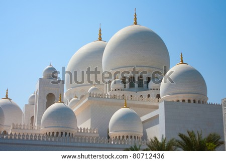 Domes of Sheikh Zayed mosque in Abu Dhabi. The third biggest mosque in the world. - stock photo