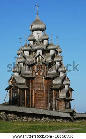 domes of the famous Church of the Transfiguration (Kizhi ensemble), the masterpiece of wooden architecture - stock photo