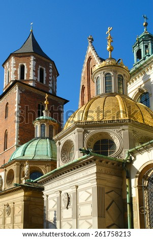 Domes of two Renaissance chapels on the side of the cathedral on Wawel Hill in Krakow Poland. Poland's monarchs used to be crowned here. The chapel with the golden dome is Kaplica Zygmuntowska - stock photo