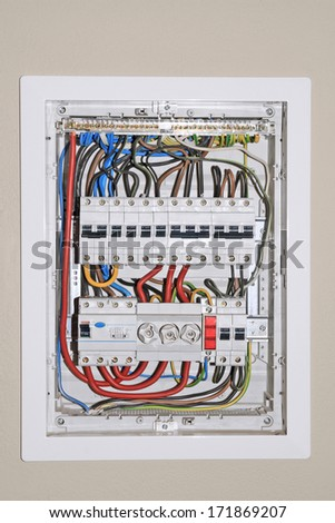 Domestic electrical distribution board, mounted on wall - stock photo