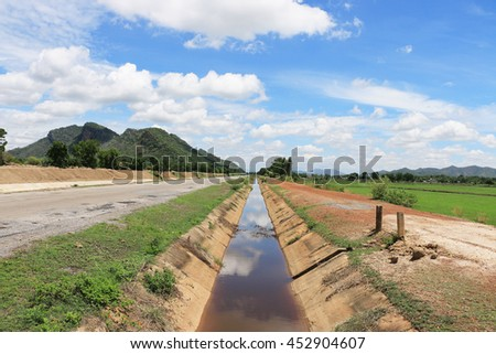 Domestic irrigation canal for agriculture crops in Thailand - stock photo