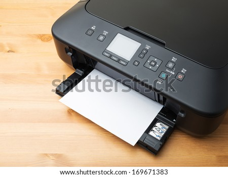 Domestic printer and paper - stock photo