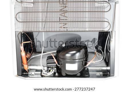 Domestic refrigerator compressor mounted on the rear side - stock photo