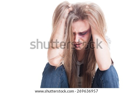 Domestic violence and despair concept with an abused and beaten woman - stock photo