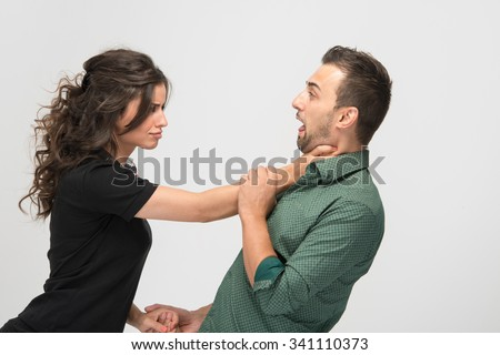 Dominant female choking her partner when she is angry - stock photo