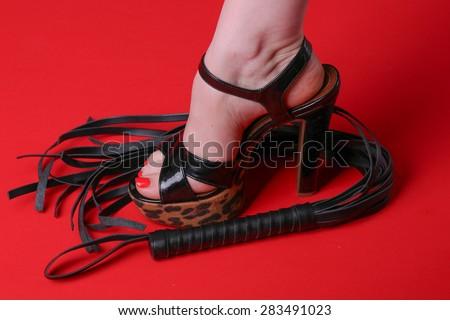 Dominant woman foot - stock photo