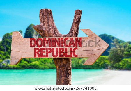 Dominican Republic wooden sign with beach background - stock photo