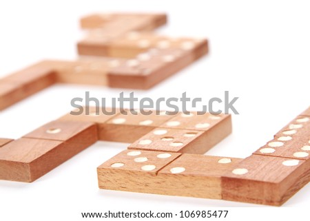 domino close up wirh soft focus isolated on white as an abstract concept - stock photo