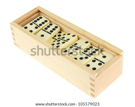 Domino in wooden box against the white background - stock photo