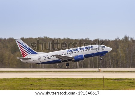 DOMODEDOVO AIRPORT (DME), RUSSIA - April 28, 2014: Transaero Airlines Boeing 737-500 aircraft takeoff on the runway of Domodedovo International Airport in Moscow region on April 28, 2014.  - stock photo
