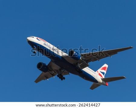 Domodedovo - March 14, 2015: A passenger plane Boeing 777, British Airways, landing at Domodedovo airport and blue sky March 14, 2015, Domodedovo, Moscow Region, Russia - stock photo