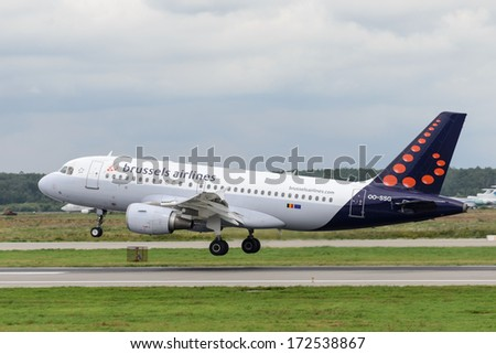DOMODEDOVO, RUSSIA - JULY 20: Aircraft operated by Brussels Airlines, landing in Moscow airport Domodedovo on July 20, 2013. The company in its fleet has 16 aircraft Airbus-A319 - stock photo