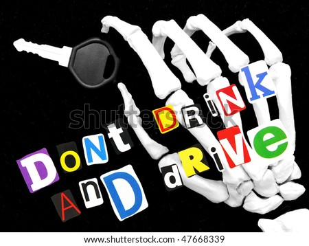 don't drink and drive - skeletal hand holding a car key - stock photo
