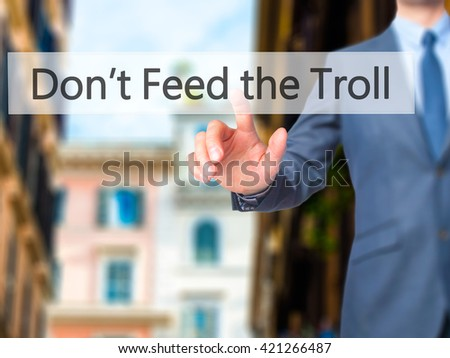 Don't Feed the Troll - Businessman hand pressing button on touch screen interface. Business, technology, internet concept. Stock Photo - stock photo