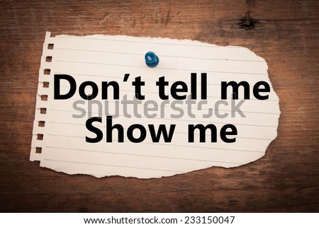 don,t tell me show me  text on wood background  - stock photo