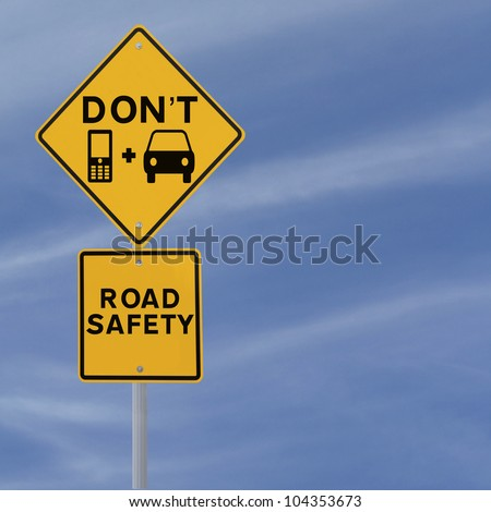 Don't Text & Drive! - Modified road sign highlighting the danger of texting and driving against a blue sky background with copy space) - stock photo