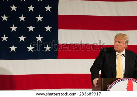 Donald Trump speaks at the First in the Nation Leadership Summit in Nashua, NH, on April 18, 2015 - stock photo