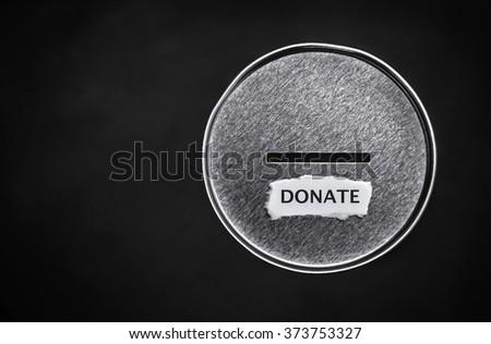 donation box over black background - stock photo