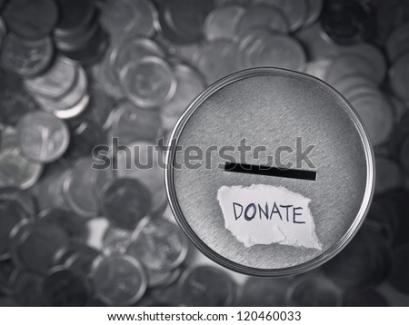donation box with coins in monotone - stock photo