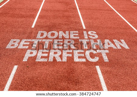 Done is Better than Perfect written on running track - stock photo