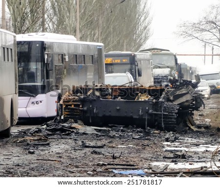 DONETSK BASIN, UKRAINE - FEBRUARY 6, 2015: A bus column for refugees, escorted by pro-Russian rebels, which moves between Debaltseve and Uglegorsk cities  - stock photo