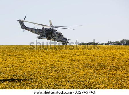 DONETSK REG, UKRAINE - Aug 02, 2015: Ukrainian military helicopter Mi-24 (Hind) in flight on combat duty in the area of the antiterrorist operation - stock photo