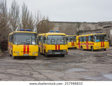 Donetsk, Ukraine - April, 11, 2014: Buses rescuers at the mine named after Skochinskiy during work to rescue the miners blocked and retrieval of those killed in the accident - stock photo