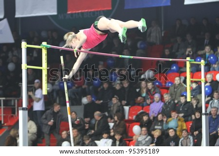 DONETSK, UKRAINE - FEB.11: Anna Shleh wins women's competition with Ukrainian National Record and the result 5.60 on Samsung Pole Vault Stars meeting on February 11, 2012 in Donetsk, Ukraine. - stock photo