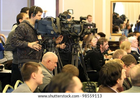 DONETSK, UKRAINE - FEB.11: cameras of mass media on the press conference before Samsung Pole Vault Stars meeting on February 10, 2012 in Donetsk, Ukraine - stock photo