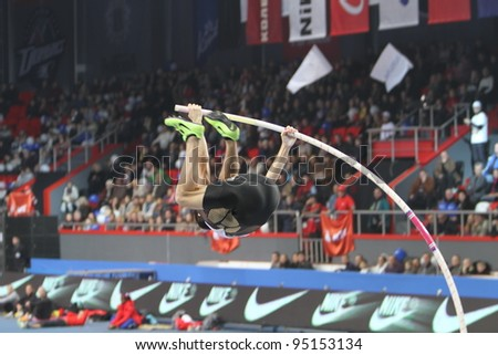 DONETSK,UKRAINE-FEB.11: Lavillenie Renaud wins men's competition with the result 5.82 on Samsung Pole Vault Stars meeting on February 11, 2012 in Donetsk, Ukraine. He won gold at 2009 European Champ. - stock photo