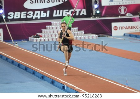DONETSK, UKRAINE - FEB.11: Maksym Mazuryk competes in the Samsung Pole Vault Stars meeting on February 11, 2012 in Donetsk, Ukraine. He won silver medal in the pole vault event at 2010 European Championships. - stock photo