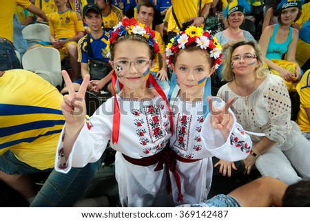 "DONETSK, UKRAINE - JUNE 15: Ukraine national football team supporters show their support during UEFA EURO 2012 on ""DONBAS ARENA"" soccer stadium in Donetsk on June 15, 2012 in Donetsk, Ukraine. - stock photo"