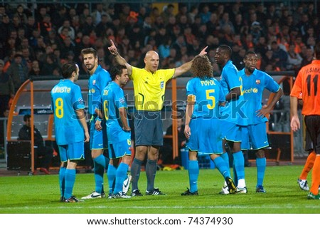 DONETSK, UKRAINE - OCTOBER 1:    FC Barcelona players arguing with referee during the match of Champions League vs FC Shakhtar  on October 1, 2008 in Donetsk, Ukraine - stock photo