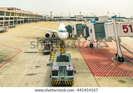 DONMUANG INTERNATIONAL AIRPORT, BANGKOK,THAILAND - MAY 30, 2016: Thai Smile Airways flight WE-283 load passengers and luggage before fly from Donmuang Intenational Airport to Phuket  Airport. - stock photo