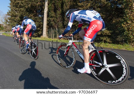 DONORATICO, LIVORNO, ITALY - MARCH 07: Team Lotto Belisol during the 1st Team Time Trial stage of 2012 Tirreno-Adriatico on March 07, 2012 in Donoratico, Livorno, Italy - stock photo