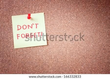 dont forget or do  not forget reminder, written on Yellow Sticker on Cork Bulletin or Message Board.  - stock photo