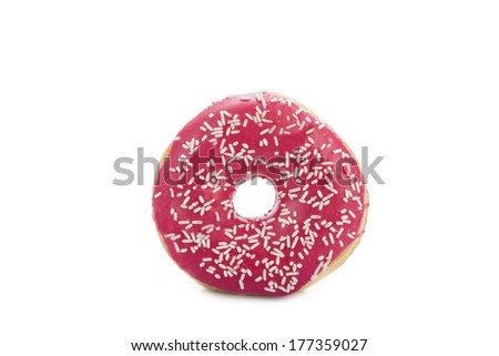 Donut covered in red sugar and White sprinkles  isolated over a white background - stock photo