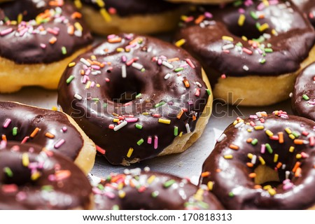 Donut with Chocolate Icing and Sprinkles  - stock photo
