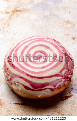 donut with spiral frosting on steel plate - stock photo