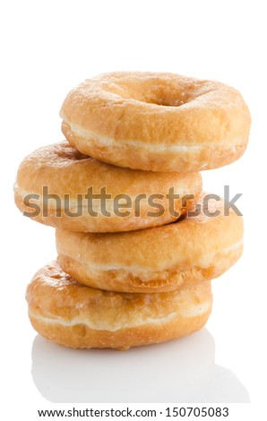 Donuts on a white reflective background. - stock photo