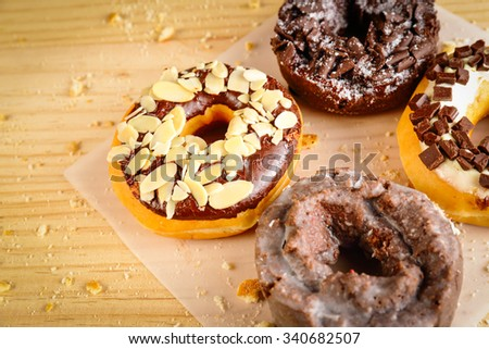 Donuts on wooden background - stock photo