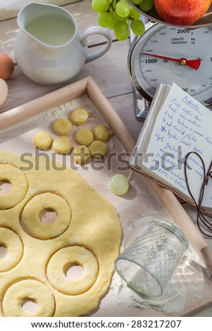 Donuts with fresh ingredients in the rustic kitchen - stock photo