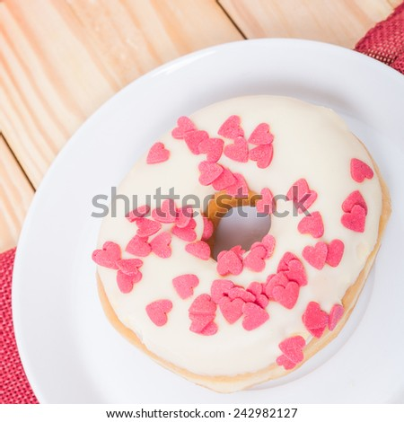 donuts with sugar hearts - stock photo