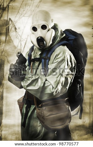 Doomsday. Man in gas mask with gun and backpack - stock photo