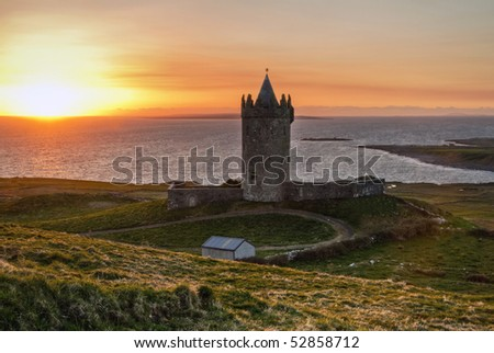 Doonagore castle at sunset - stock photo