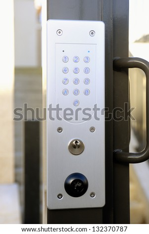 door code of entry from building modern and nine on the wicket giving on the street - stock photo