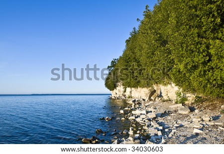 Door County Shoreline with Washington Island in the Distance - stock photo