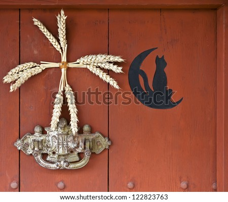 Door detail with the moon and a black cat, France - stock photo